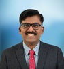 Dr Satish K David